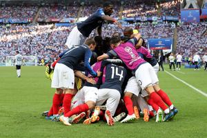 FRENCH FANCY: France's Paul Pogba, top, celebrates with teammates after France's Kylian Mbappe scored his side's third goal during the last 16 win over Argentina at the Kazan Arena last Saturday