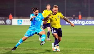 San Marino's Manuel Battistini (left) and Scotland's Johnny Russell battle for the ball
