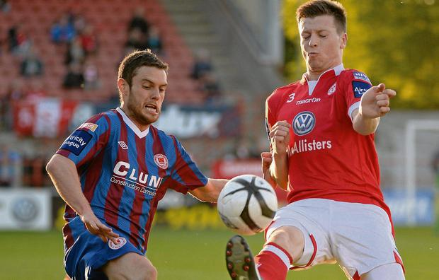 Jack Memery, Shelbourne, in action against John Russell, St. Patrick's Athletic Picture: Paul Mohan / SPORTSFILE