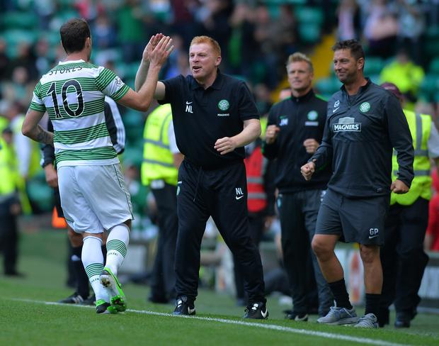Anthony Stokes of Celtic celebrates with manager Neil Lennon. Picture: Mark Runnacles/Getty Images