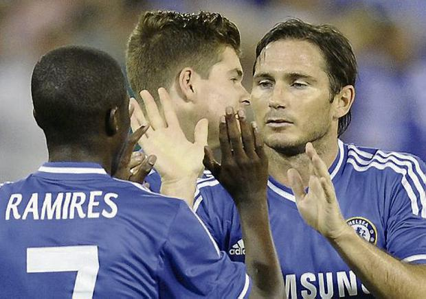 Chelsea midfielder Frank Lampard, right, celebrates his goal with teammate Ramires (7). Picture: AP/Nick Wass