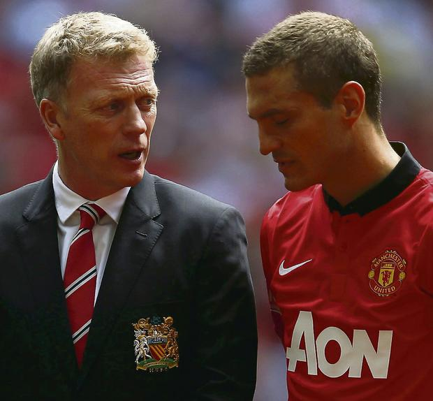 Manchester United's new manager David Moyes speaks to his captain Nemanja Vidic before their kick off against Wigan Athletic in the Community Shield. Photo: REUTERS/Eddie Keogh