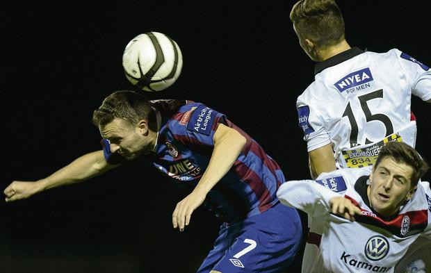 GETTING AHEAD: Conan Byrne of St. Pat's in action against Luke Byrne (15) and Keith Buckley of Bohemians at Richmond Park.