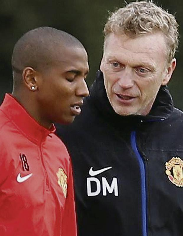 Manchester United's manager David Moyes talks with Ashley Young. Picture credit: REUTERS/Phil Noble