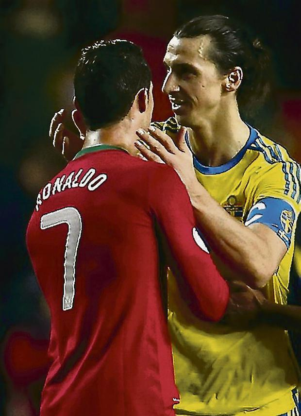 Sweden's Zlatan Ibrahimovic (R) congratulates Portugal's Cristiano Ronaldo after their 2014 World Cup first leg qualifying play-off. Picture credit: Rafael Marchante / REUTERS