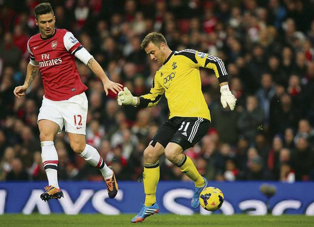 Goalkeeper Artur Boruc of Southampton loses the ball to Olivier Giroud of Arsenal. Photo: Clive Rose/ Getty Images