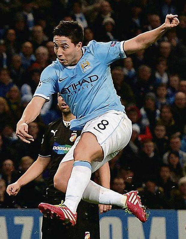 Manchester City's Samir Nasri scoring in the Champions League. Picture credit: Nigel Roddis/REUTERS