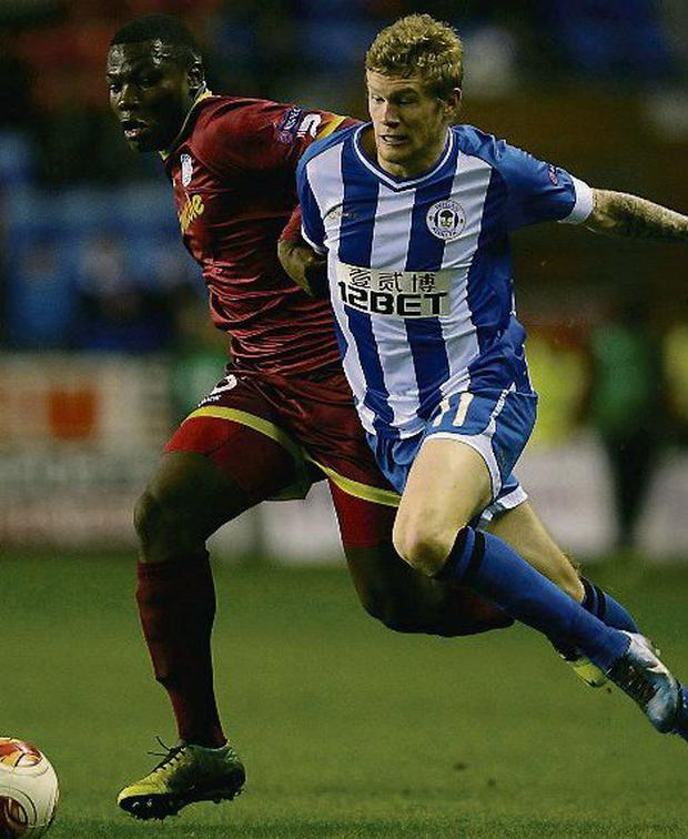 Wigan Athletic's James McClean (right). Photo: Reuters/ Nigel Roddis