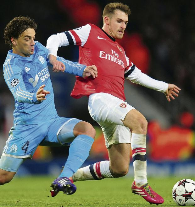SUPERB FORM: Aaron Ramsey (right)