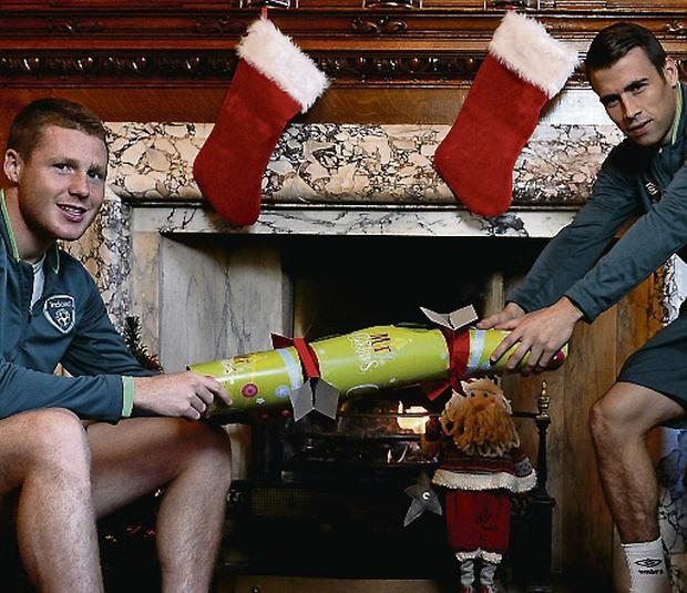 Republic of Ireland internationals James McCarthy, left, and Seamus Coleman help launch the FAI's Christmas bundle offer.