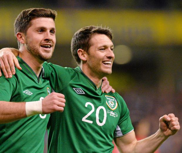 Shane Long, Republic of Ireland, celebrates with team-mate Wes Hoolahan, right, after scoring against Serbia