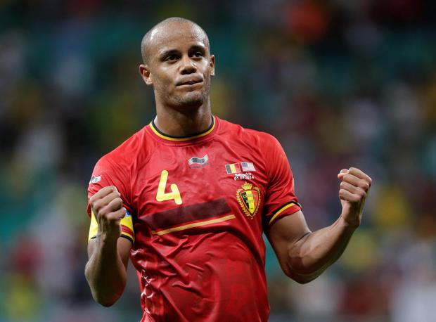 Belgium's Vincent Kompany celebrates after the World Cup round of 16 soccer match between Belgium and the USA at the Arena Fonte Nova in Salvador, Brazil, Tuesday, July 1, 2014. Picture: AP Photo/Julio Cortez.