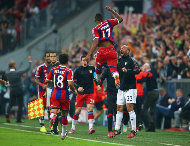Jerome Boateng of Bayern Muenchen jumps for joy as he celebrates scoring his goal