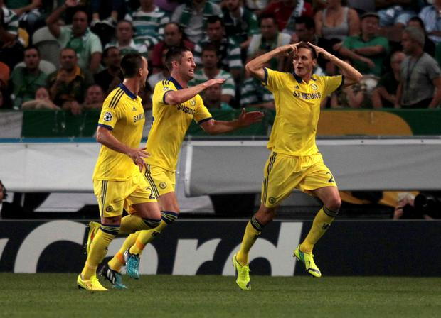 Chelsea's Nemanja Matic (R) celebrates with team mates after scoring a goal against Sporting Lisbon