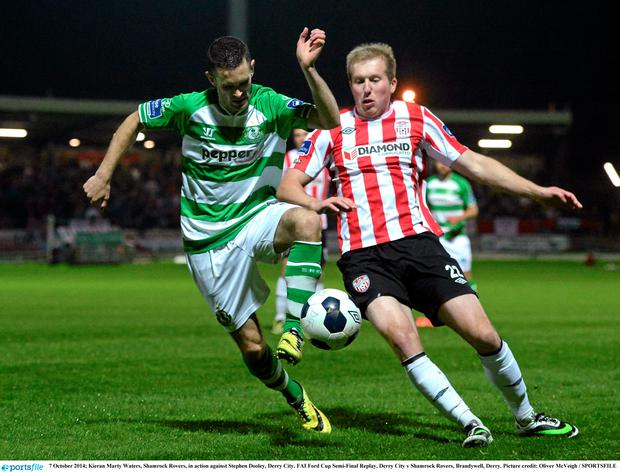 Kieran Marty Waters, Shamrock Rovers, in action against Stephen Dooley, Derry City.