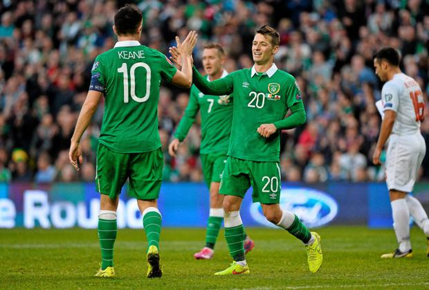 Wes Hoolahan, Republic of Ireland, celebrates with team-mate Robbie Keane after scoring his side's seventh goal