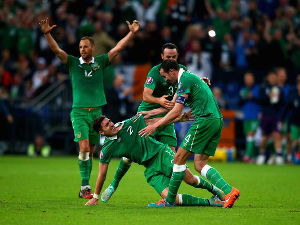 GELSENKIRCHEN, GERMANY - OCTOBER 14: John O'Shea of the Republic of Ireland (R) celebrates scoring the equalising goal with Marc Wilson and Stephen Ward of the Republic of Ireland during the EURO 2016 Qualifier between Germany and Republic of Ireland at the Veltins-Arena on October 14, 2014 in Gelsenkirchen, Germany. (Photo by Alex Grimm/Bongarts/Getty Images)