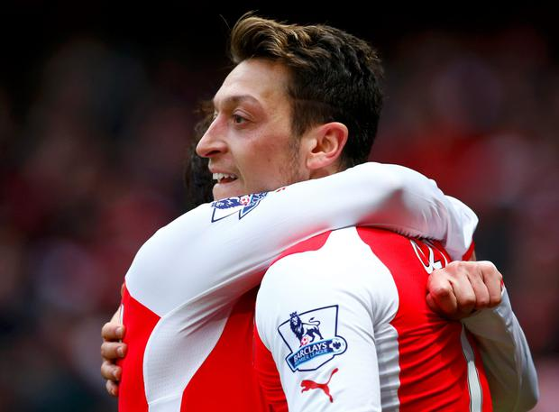 Arsenal's Mesut Ozil (R) celebrates his goal against Aston Villa with Santi Cazorla
