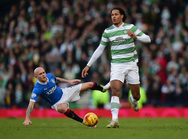 Virgil van Dijk of Celtic breaks clear of Nicky Law of Rangers during the Scottish League Cup Semi-Final