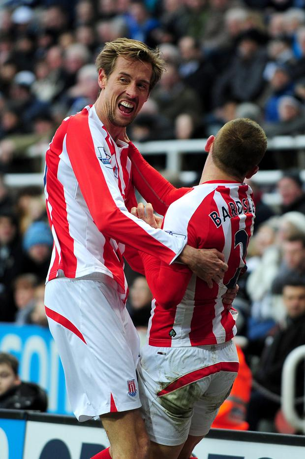 Stoke City's Peter Crouch celebrates scoring their first goal of the game with team-mate Phil Bardsley (right) during the Barclays Premier League match at St James' Park