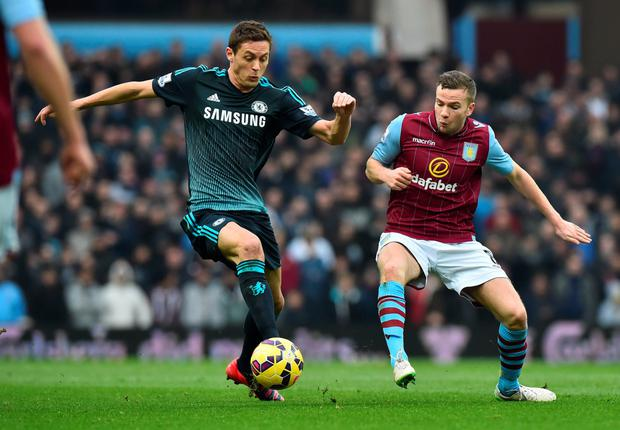 Chelsea's Serbian midfielder Nemanja Matic (L) vies with Aston Villa's English midfielder Tom Cleverley