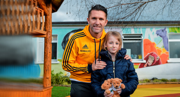 Republic of Ireland international and LA Galaxy player Robbie Keane with Laura Crossan, aged 9, from Monaghan, during a visit to Our Lady's Children's Hospital, Crumlin, Dublin
