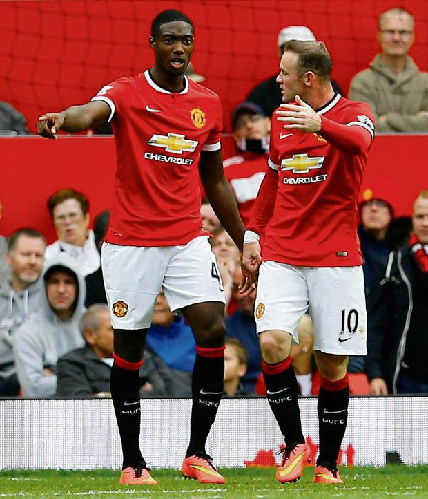 Tyler Blackett and Wayne Rooney