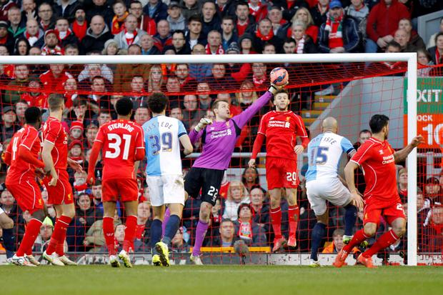 Liverpool goalkeeper Simon Mignolet makes a goal-line save to deny Blackburn