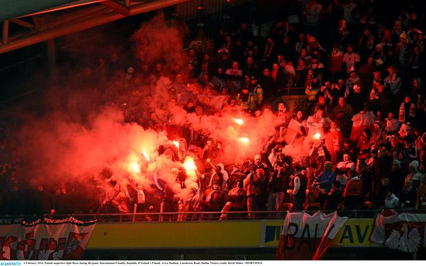 Poland supporters light flares