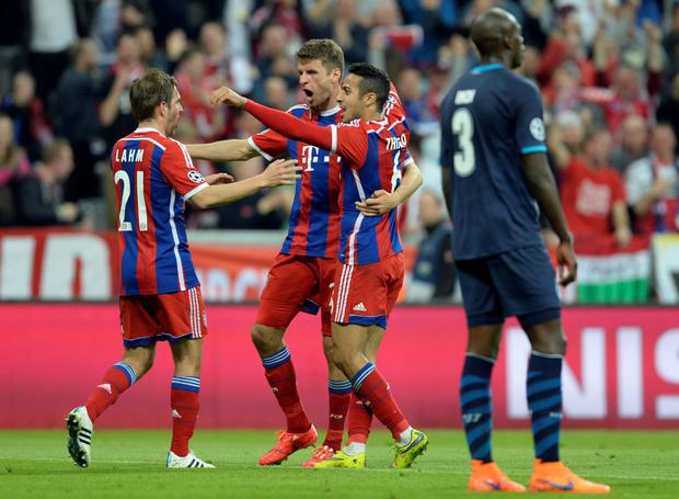 Bayern Munich defender Philipp Lahm (left) celebrates with midfielder Thomas Mueller (centre) and Spanish midfielder Thiago Alcantara after Mueller's goal in the Champions League quarter-final second leg win over Porto.
