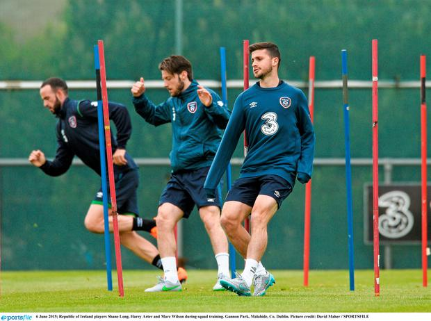Republic of Ireland players Shane Long, Harry Arter and Marc Wilson during squad training. Gannon Park, Malahide,