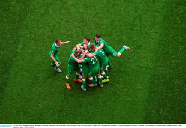 Jonathan Walters, Republic of Ireland, celebrates with team-mates after scoring his side's first goal. UEFA EURO 2016 Championship Qualifier, Group D, Republic of Ireland v Scotland, Aviva Stadium, Lansdowne Road, Dublin. Picture credit: Rams