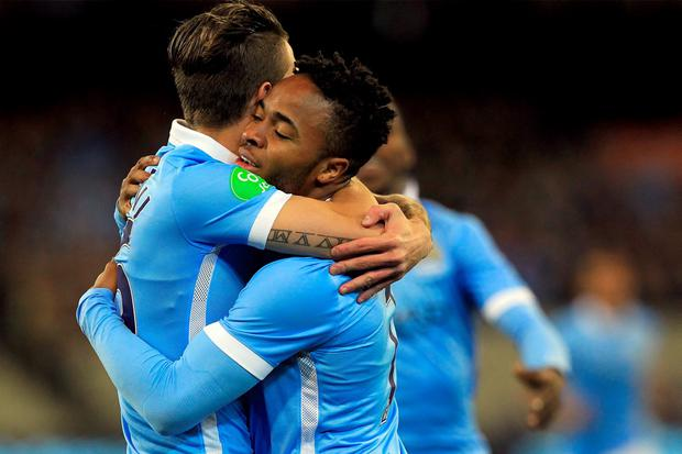 Manchester City's Raheem Sterling is congratulated by Bruno Zuculini after scoring early during their match against AS Roma in Melbourne