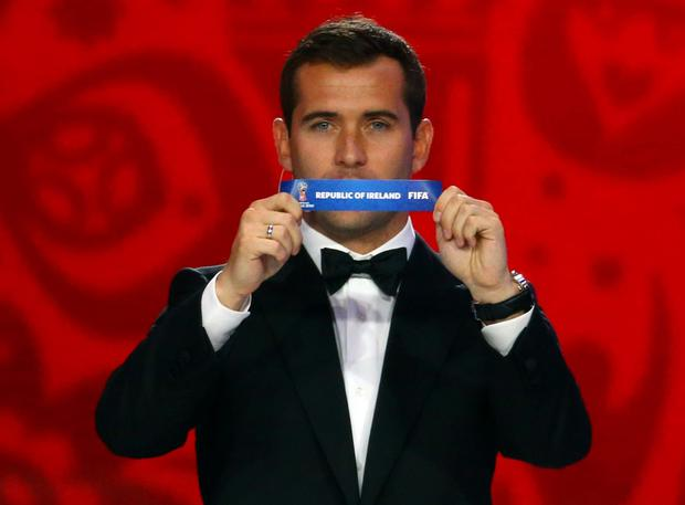 Former Russian player Aleksandr Kerzhakov holds up the slip showing 'Ireland' during the draw for the 2018 FIFA World Cup in St Petersburg, Russia