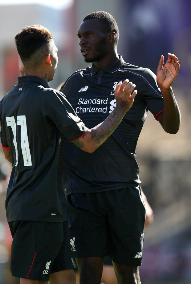 Christian Benteke (r) celebrates his goal against Swindon