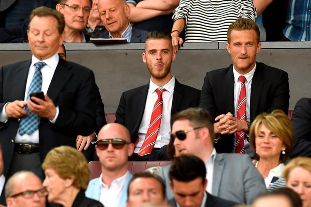 David de Gea (pictured left with fellow Manchester United goalkeeper Anders Lindergard) will not be selected by manager Louis van Gaal until he commits to the club