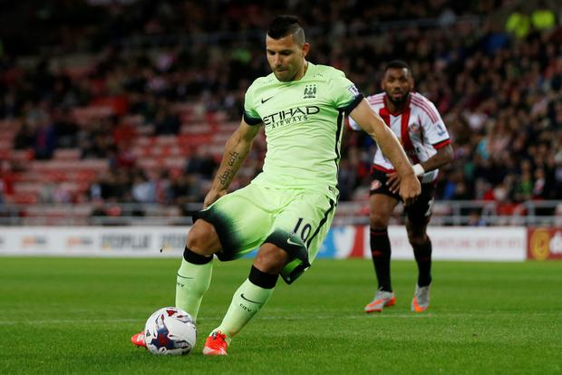 Sergio Aguero scores the first goal for Manchester City from the penalty spot against Sunderland on Tuesday night