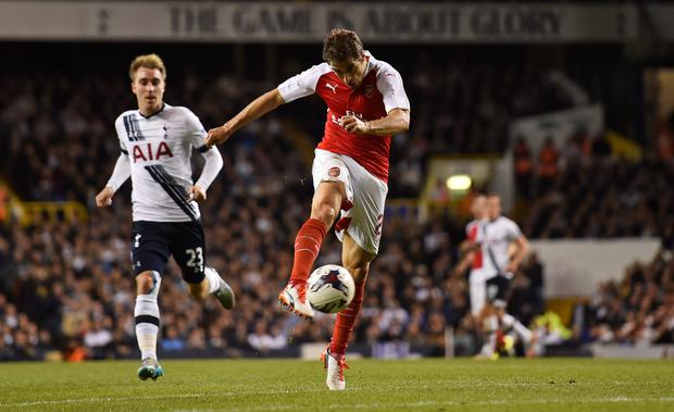 Flamini volleys home his side's winner in the League Cup clash with Tottenham Hotspur