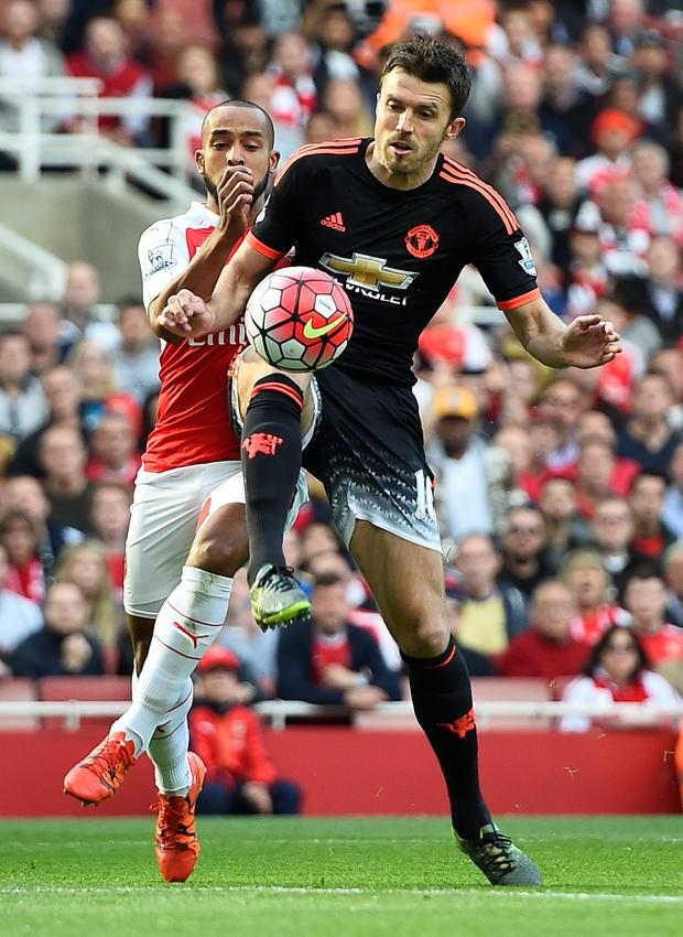 Manchester United's Michael Carrick, pictured in action against Arsenal's Theo Walcott last Sunday.