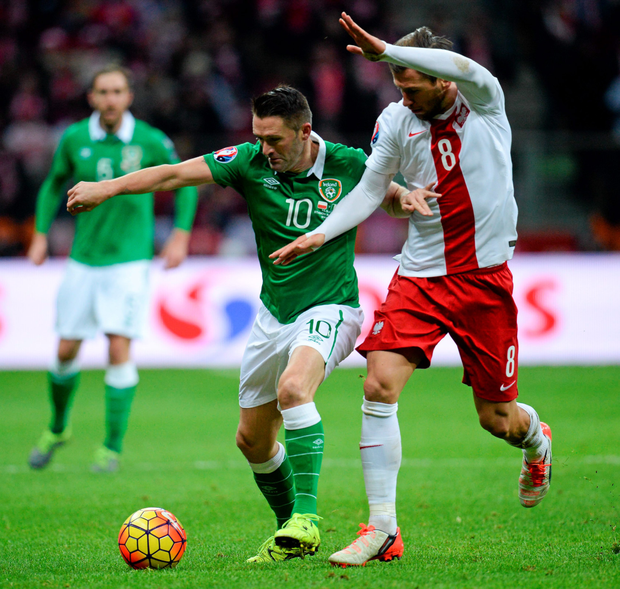 Republic of Ireland's Robbie Keane in action against Poland's Grzegorz Krychowiak in Warsaw