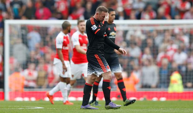Manchester United's Wayne Rooney walks off the Emirates turf dejected at half-time during the recent thrashing by Arsenal