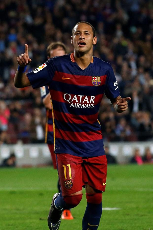 Barcelona's Neymar celebrates a goal against Rayo Vallecano during their Spanish first division soccer match
