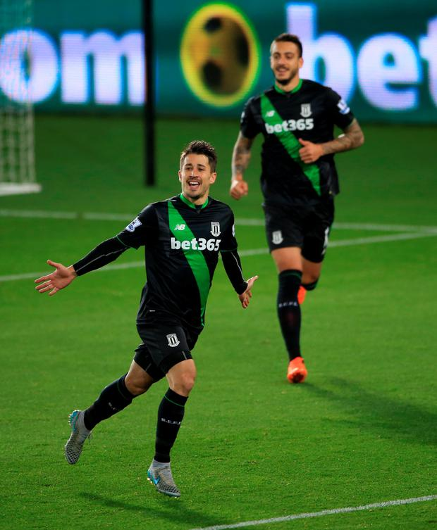 Stoke City's Bojan Krkic (left) celebrates scoring his sideÄôs first goal of the game