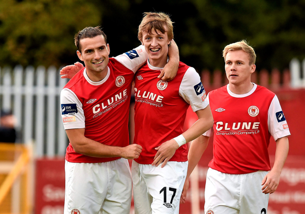 St Patrick's Athletic's Christy Fagan, left, celebrates after scoring his side's first goal with team-mates Chris Forrester, left, and Conor McCormack