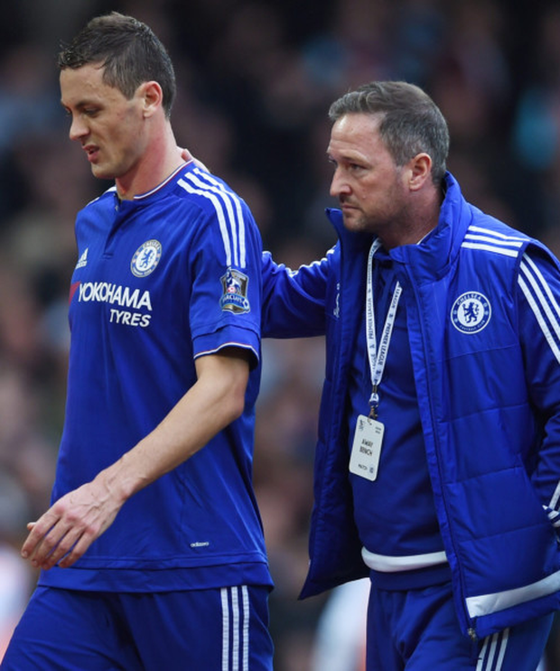 Chelsea's Nemanja Matic, with first-team coach Steve Holland, after being sent off against West Ham