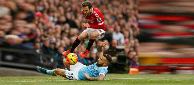 Manchester United's Juan Mata in action with Manchester City's Nicolas Otamendi