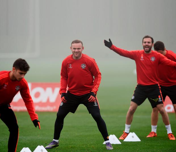 Manchester United's English striker Wayne Rooney (C) takes part in a training session in Manchester