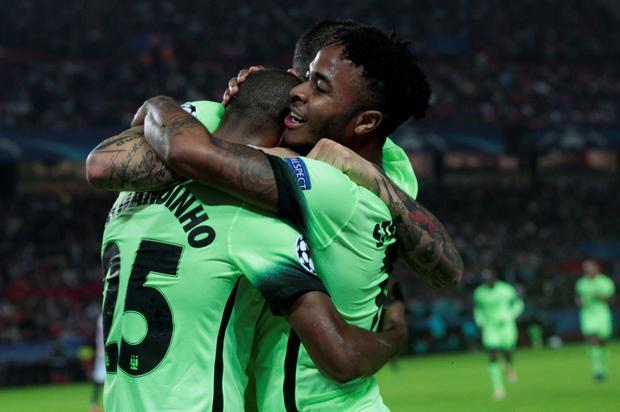 Raheem Sterling celebrates his opening goal with team-mate Fernandinho