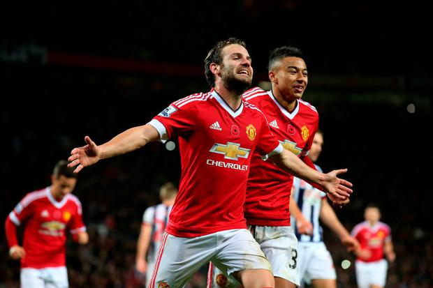 MANCHESTER, ENGLAND - NOVEMBER 07: Juan Mata of Manchester United celebrates scoring his team's second goal during the Barclays Premier League match between Manchester United and West Bromwich Albion at Old Trafford on November 7, 2015 in Manchester, Engla