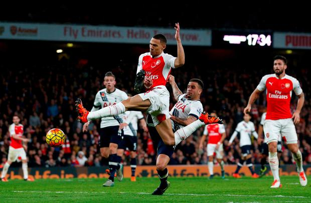 Arsenal's Kieran Gibbs gets the equaliser against Tottenham Hotspur at the Emirates Stadium